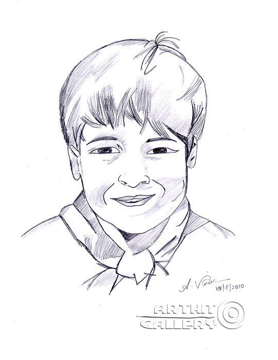 'Innocent boy`s smile for photograph'. Anandhan Vignesh